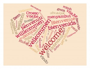 """An image of a heart made up of the word """"welcome"""" in various languages"""