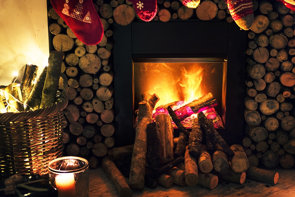 fireplace with candles around it